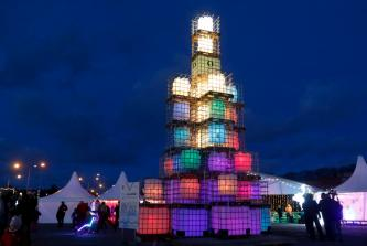 epa08038046 A Christmas tree is on display in Viimsi, Estonia, 01 December 2019. The about 12m-high Christmas tree was designed by artist Teet Suur from some 1,500 pieces of four-liter windscreen wash canisters. EPA-EFE/VALDA KALNINA