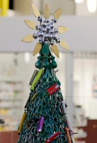 epa08070466 A Christmas tree decorated by using items that passengers had to leave behind a security check at Vilnius Airport, in Vilnius, Lithuania, 14 December 2019. Vilnius Airport staff decided to make a special Christmas tree decorated with confiscated knives, scissors, toy guns and other items, to remind travellers about safety. EPA-EFE/VALDA KALNINA