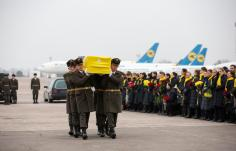 epa08140947 A handout photo made available by the Presidential Press Service of Ukraine showing relatives, friends and officials meet coffins with bodies of crew members and victims of the Ukraine International Airlines Flight PS752 at Boryspil International Airport in Kiev, Ukraine, 19 January 2020 after their bodies were returned from Iran. Iran admitted on 11 January that its armed forces had downed a Ukraine International Airlines passenger jet with 176 civilians on board and said it had been an involuntary human error. EPA-EFE/HANDOUT HANDOUT EDITORIAL USE ONLY/NO SALES