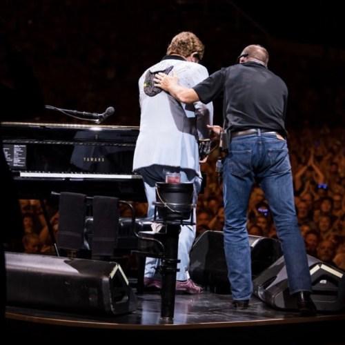 Elton John cuts gig short after suffering from walking pneumonia