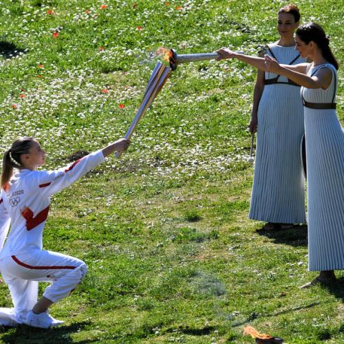 The Olympic flame ignited in scaled-down ceremony