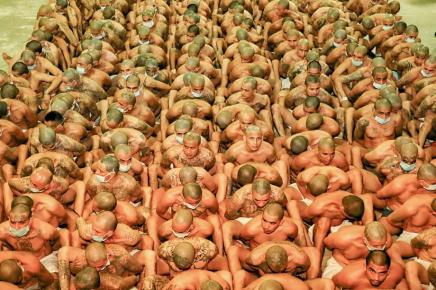 epa08385620 A handout photo made available by the El Salvador Presidency shows inmates during an inspection at the Maximum Security Jail in Zacatecoluca, El Salvador, 25 April 2020 (issued 26 April 2020). Salvadorean President Nayib Bukele ordered jails to impose solitary confinement of gang leader inmates, following a wave of homicides in the country. Investigations have uncovered that part of the homicides were ordered from gang leaders in jails. EPA-EFE/El Salvador Presidency / HANDOUT HANDOUT EDITORIAL USE ONLY/NO SALES