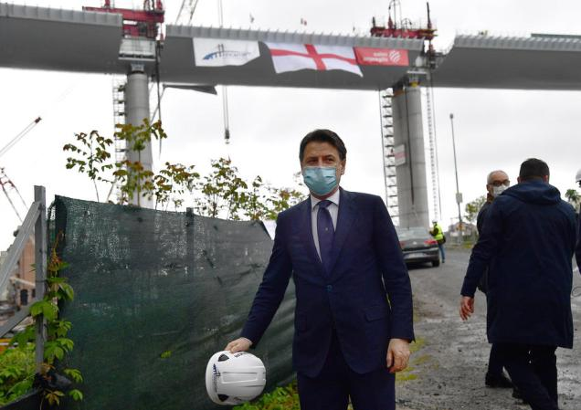 epa08388759 Italian Prime Minister Giuseppe Conte wearing a protective face mask arrives for the inauguration ceremony of the last part of the deck of the new Genoa motorway bridge in Genoa, Italy, 28 April 2020. The new Genoa bridge, designed by architect Renzo Piano, will be inaugurated 28 April in the presence of Prime Minister Conte. The new bridge is under construction after the Morandi highway bridge partially collapsed on 14 August 2018, killing a total of 43 people. EPA-EFE/LUCA ZENNARO