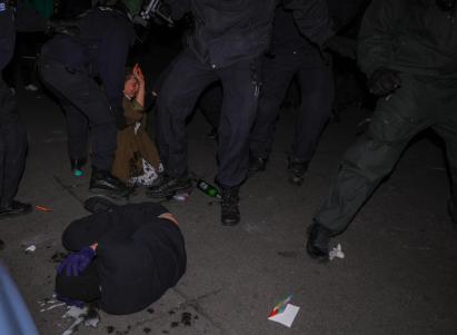 epa08396666 Police arrest a woman while a person covers on the ground during a protest on May Day in the district Kreuzberg in Berlin, Germany, 01 May 2020. The first day of May is celebrated worldwide as International Workers' Day, which marks the 1886 Haymarket labor strike and subsequent riots in Chicago, Illinois, USA. This year, May Day takes place amid the global pandemic of the COVID-19 disease caused by the SARS-CoV-2 coronavirus. EPA-EFE/OMER MESSINGER