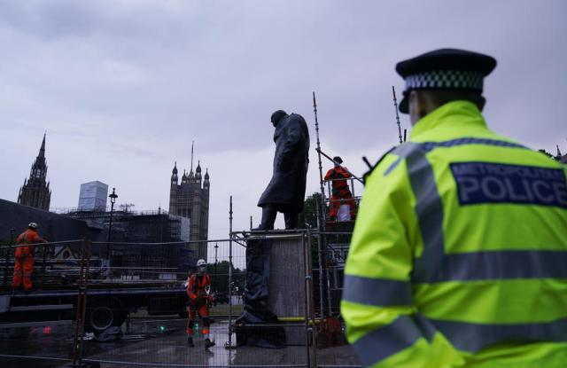 Boarded up statue of Churchill to come off