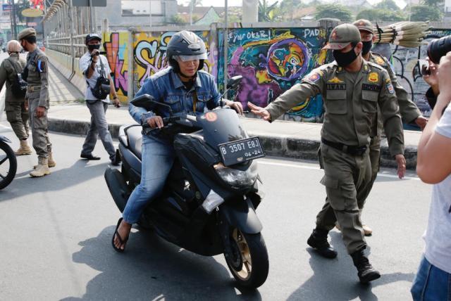 Security checks amid coronavirus pandemic in Indonesia