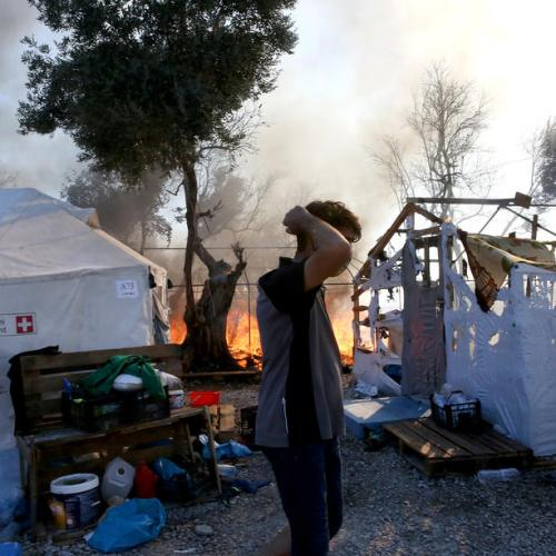 With nowhere to go after fire, Lesbos migrants sleep on roadsides, in fields