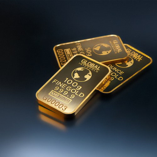 Gold reels to 4-month low on fears of early Fed tapering