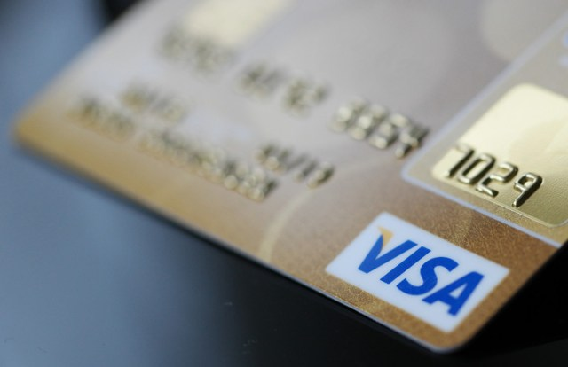 Visa profit falls 23% as payment volumes plunge