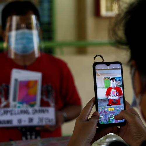 Photo Story: The Philippines issues electronic tablets to public schools for online learning