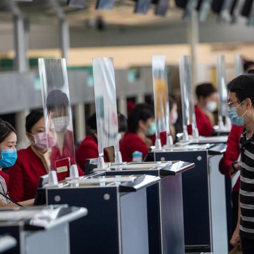 China blocks travellers from coronavirus-hit Britain, Belgium and the Philippines