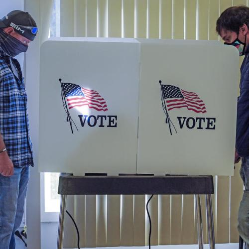 U.S. early voting surges as Trump, Biden make late push