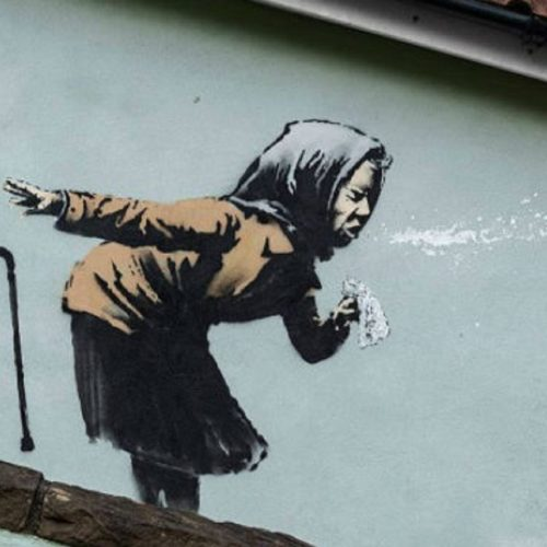 Banksy mural of sneezing woman appears on England's steepest street