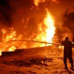 Syria says extinguishes huge fire near Homs refinery