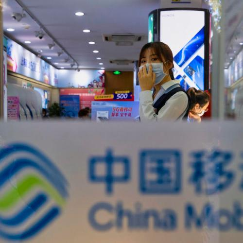 China says it will take action against U.S. delisting of its telecom firms