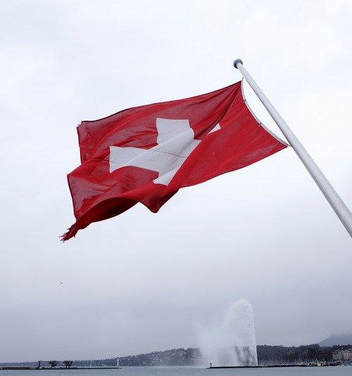 Swiss voters set to back COVID-19 law, crackdown on pesticides
