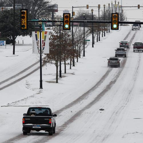 Texans struggle through historic cold