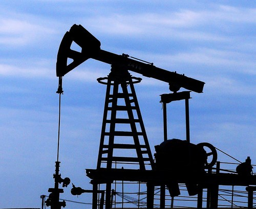 Oil prices fall on rising U.S. dollar, expectations for supply gains