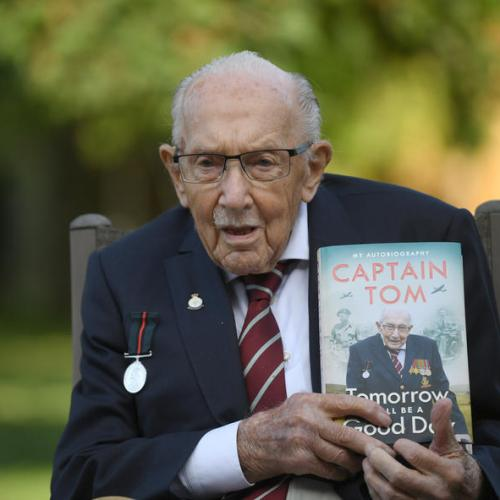Britain mourns 'hero' Captain Tom Moore with flowers and lights