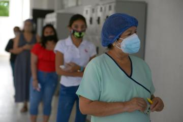 Ecuadoreans vote for president as voters lean toward socialism