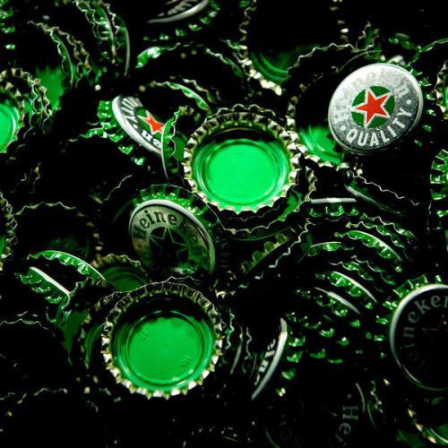 Heineken unveils 2 bln euro cost saving plan as earnings sink