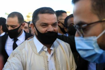 Libya PM draws crowd for mass wedding and protest against parliament