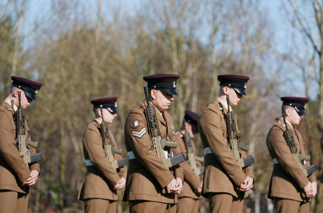 Military honours at Captain Sir Tom's funeral
