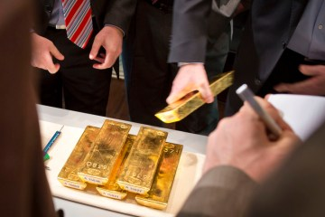 Gold firms as softer U.S. dollar, yields lift appeal