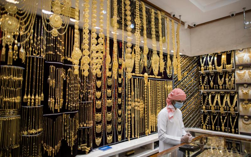 Gold slips after promising China data; set for weekly rise