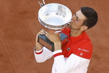 Djokovic fights back to win second French Open title