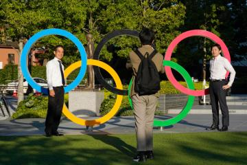 Organisers show off Olympic village a month before Games begin