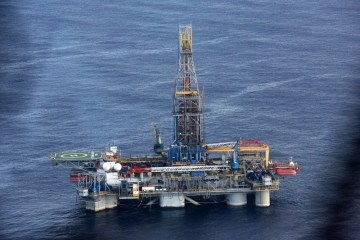 Oil prices drop, but on track for steep weekly gain
