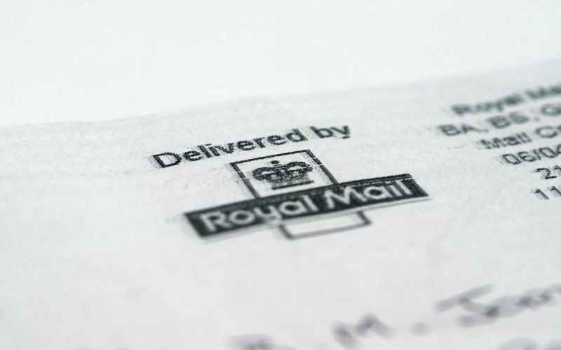 Royal Mail UK parcel volumes fall, outlook uncertain as COVID-19 curbs ease