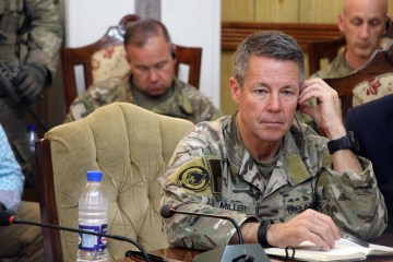 In symbolic end to war, U.S. general steps down from Afghanistan command