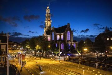 Photo Story – Westerkerk church in Amsterdam lit in rainbow colors