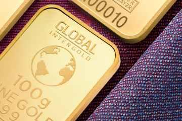 Gold firms near key $1,800 level as dollar weakens