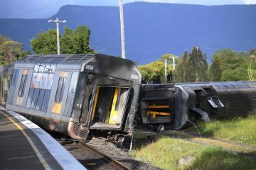 Australian passenger train derails after hitting abandoned vehicle