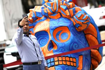 Photo Story: Giant skulls honour Frida Kahlo for the Day of the Dead in Mexico