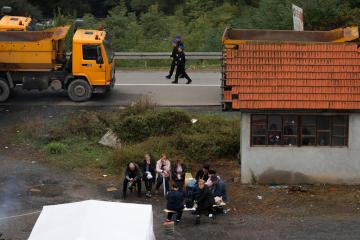 Serbs unblock roads in Kosovo as NATO moves to end car plate row