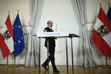 New Austrian leader takes office as opposition say Kurz remains in charge
