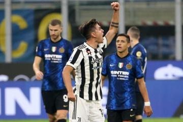 Dybala rescues point for Juve at Inter with late penalty