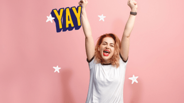 """Woman with arms raised cheering and the word 'Yay""""."""