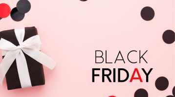Gift wrapped present on a pink background with the text 'Black Friday'.