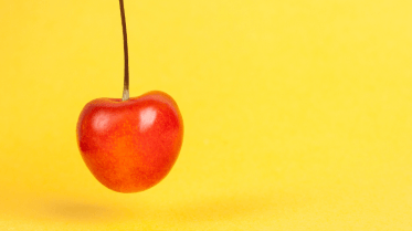 Red cherry on a yellow background