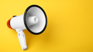 White megaphone on a yellow background