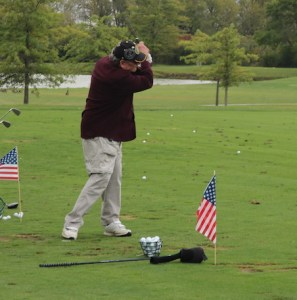 Veteran Golfing   Chicago District Golf Association Veteran swinging on driving range