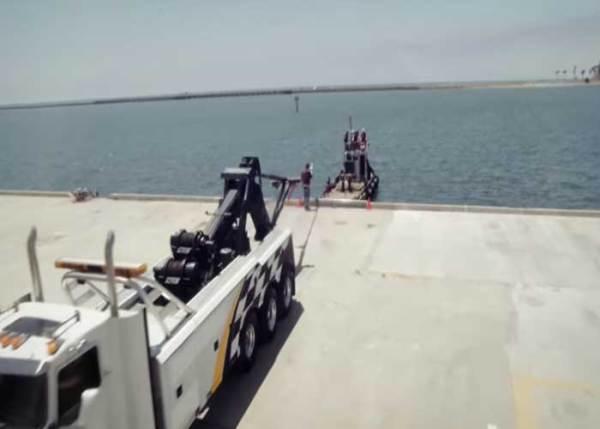 VIDEO: Tow Truck VS Tugboat Tug-O-War
