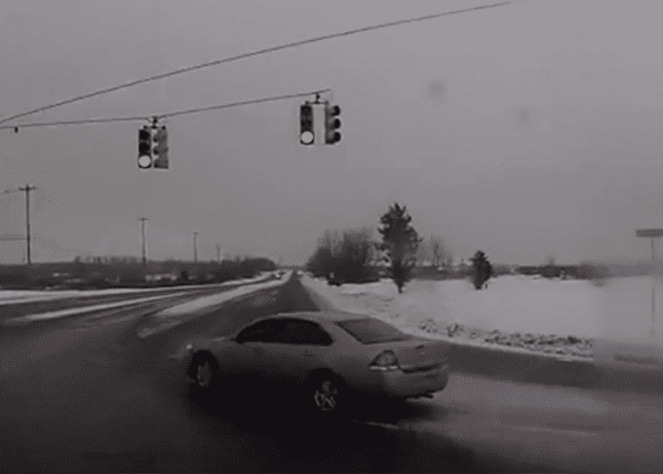 Trucker Has Close Call With Red Light Runner