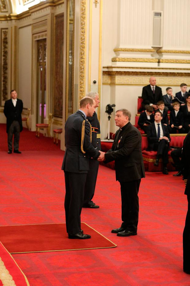 Father Brian D'Arcy is named OBE (Officer of the Order of the British Empire) by the Duke of Cambridge at Buckingham Palace. This image should not be used after March 14, 2020, without the approval of Buckingham Palace. Jonathan Brady / PA Wire