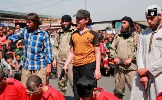 The youngsters smile as they are handed their weapons to commit the barbaric act